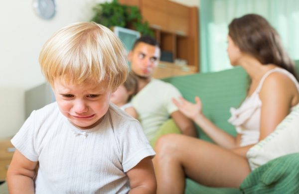 boy crying parents in background - couples therapy center of NJ
